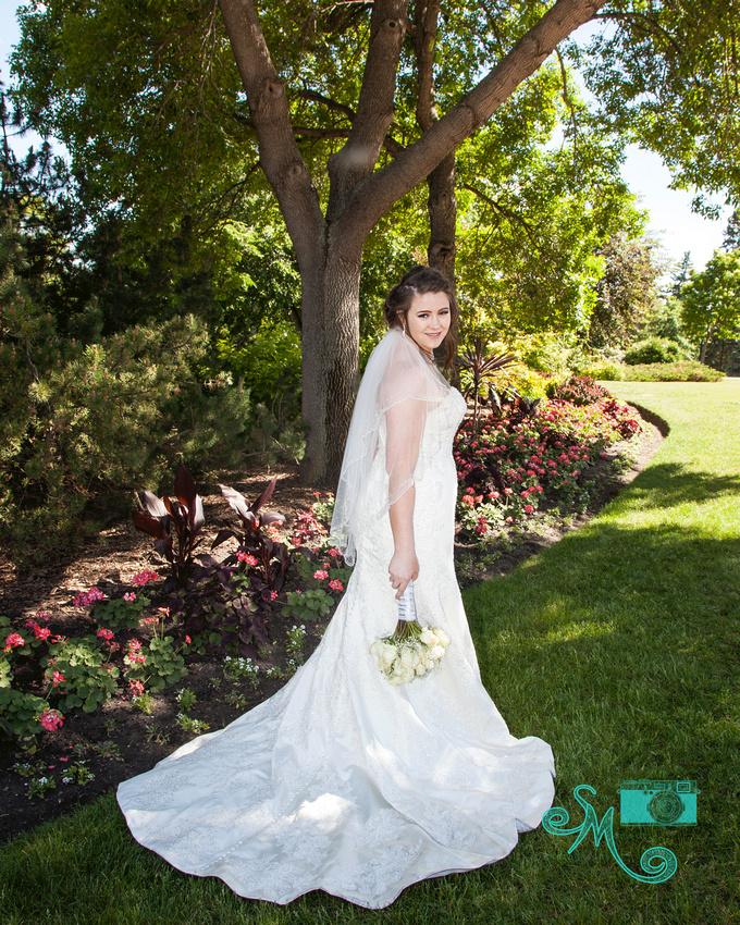 a bride turns at waist to look at camera
