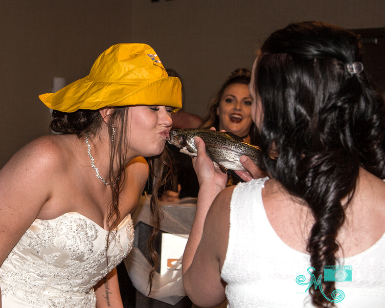 a bride gets initiated into the newfoundland culture - via kissing the cod