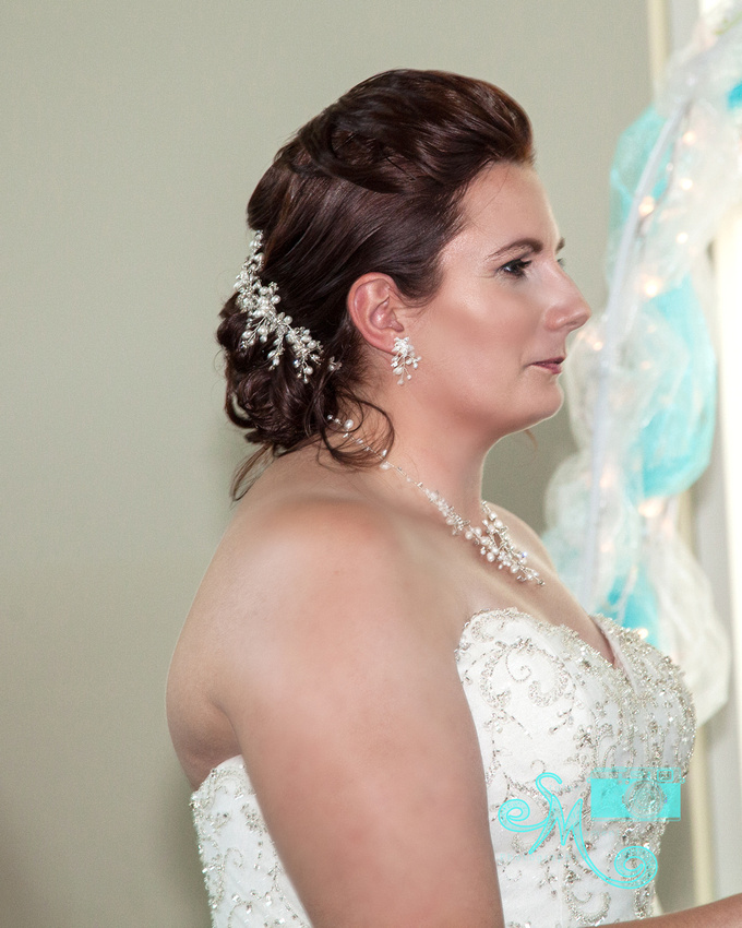 a bride gazes at her groom at the alter