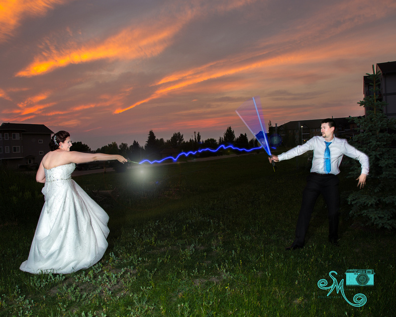 bride shoots groom with spell from wand while he uses his light sabre