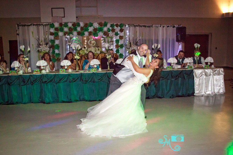 the groom dips the bride during the first dance