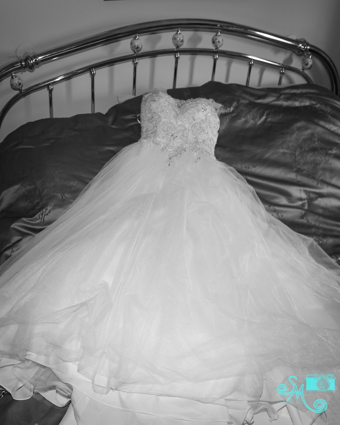 the dress laying on the bed