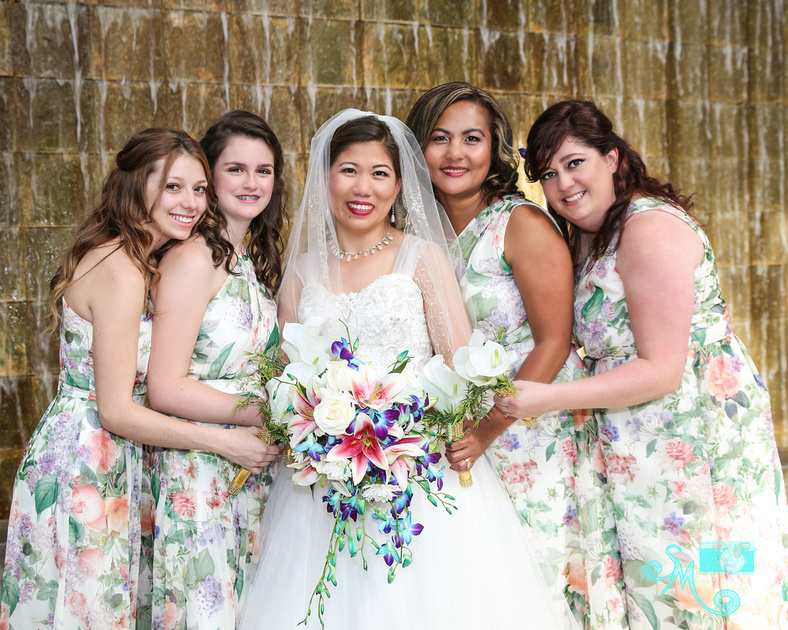 the bride and bridesmaids in front of Lee Pavilion waterfall