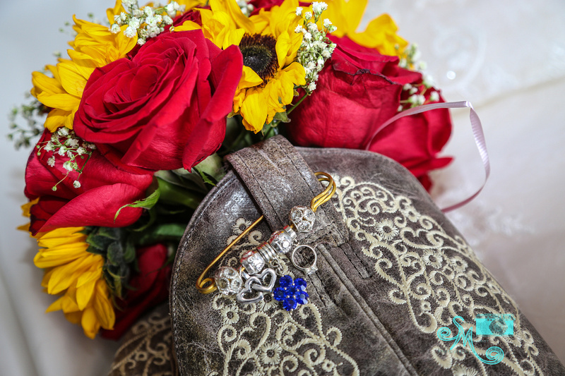the bouquet inside the cowboy boots with a clip of the bride's something blue