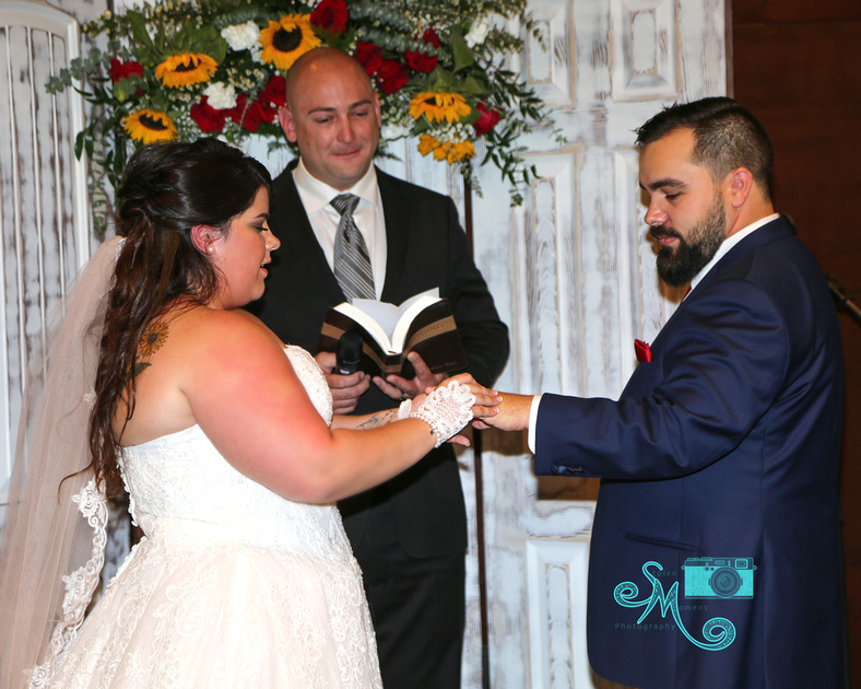 the bride puts the ring on her groom's finger