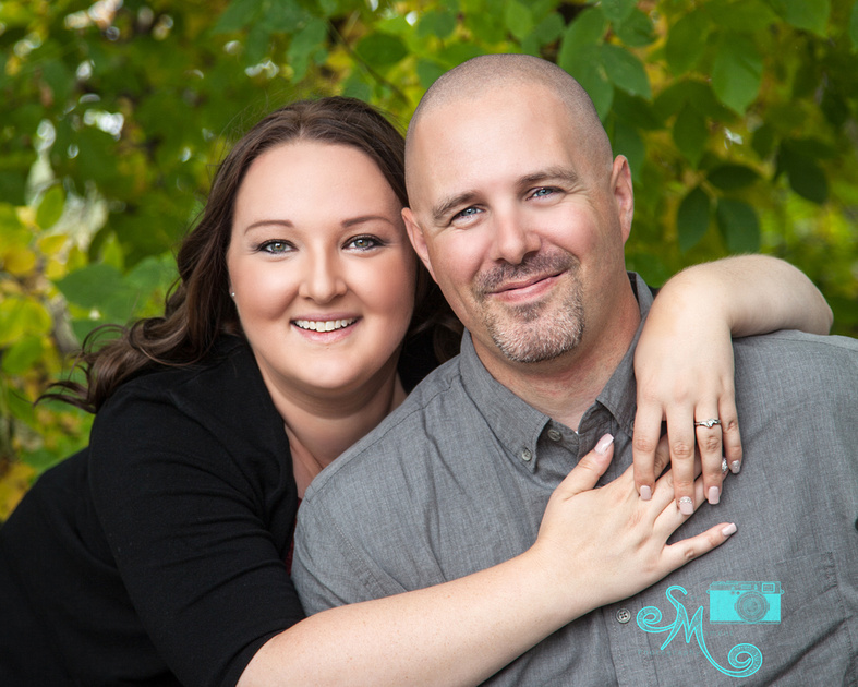 A woman puts her arms around her fiance