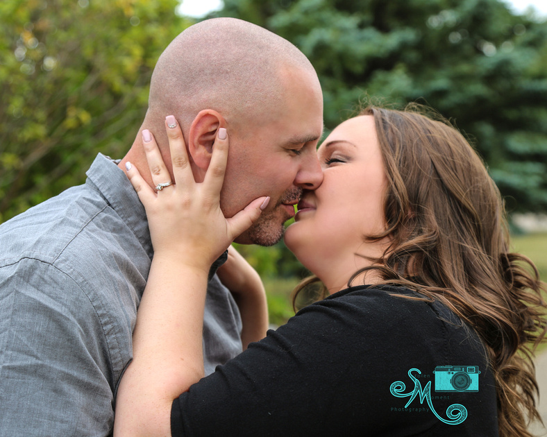 a man and his fiance almost kiss