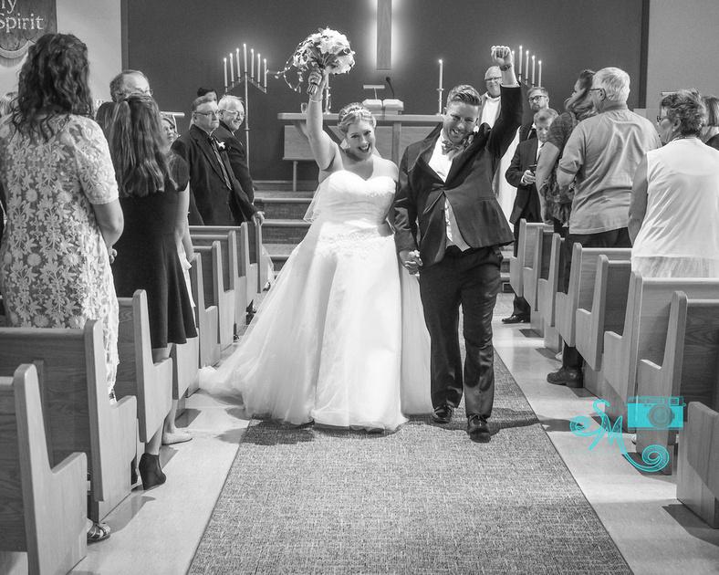 husband and wife walk down the aisle