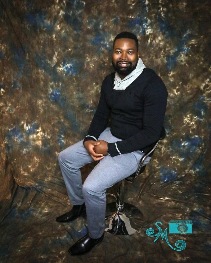 man sits on stool in studio