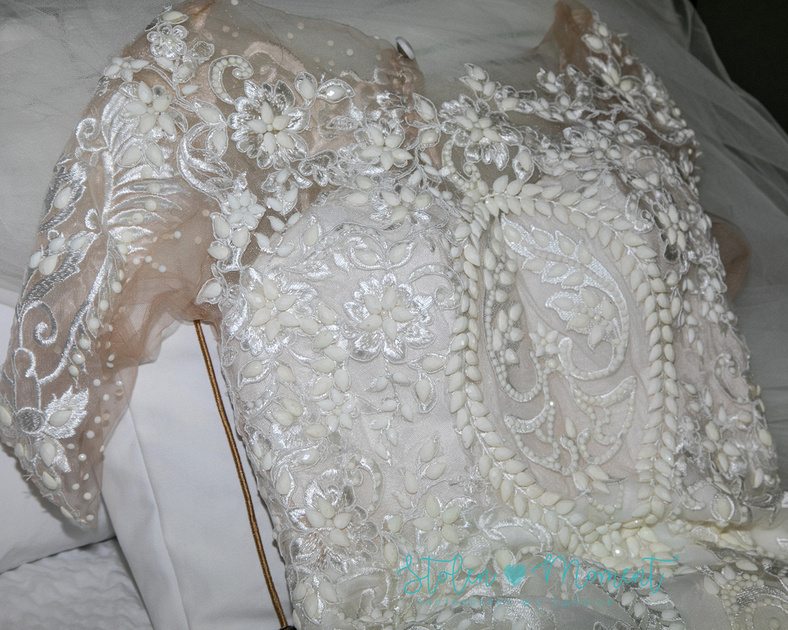 a photo showing the stunning detail on the bride's dress