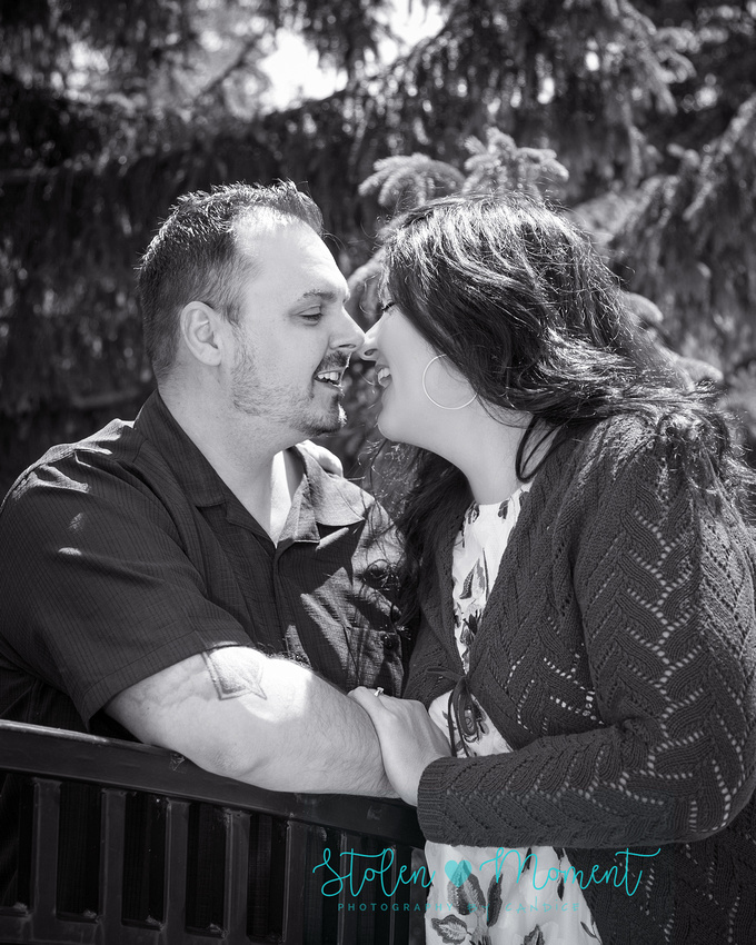 a man and his fiance almost share a kiss in Lois Hole gardens at the Alberta Legislature grounds