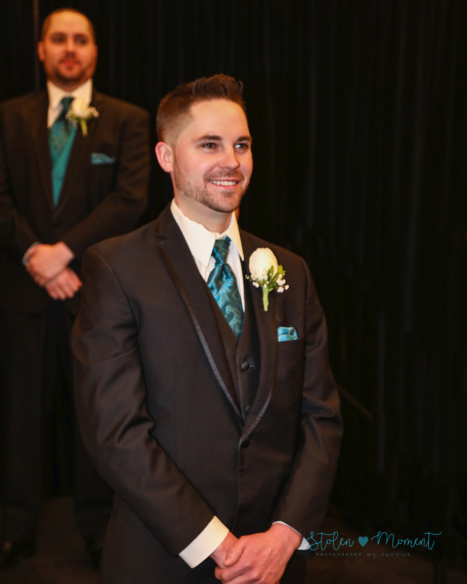 groom waiting at alter sees his bride for the first time