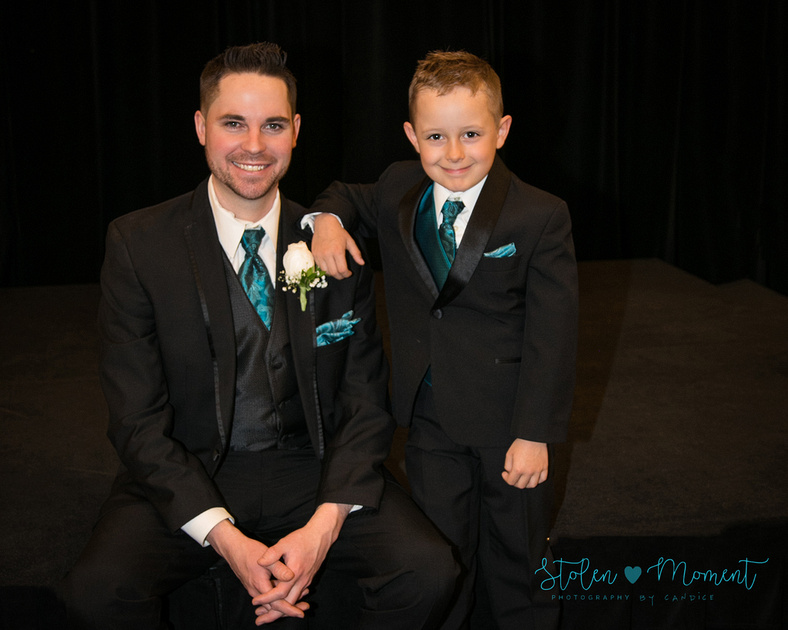 the groom sits next to his ring bearer