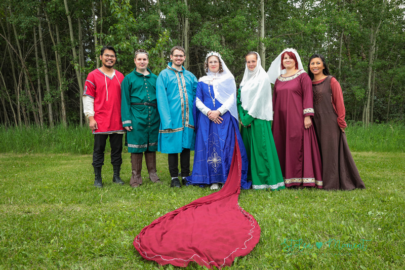 the bride stands with her six siblings all of whom are dressed in fourteenth century costume