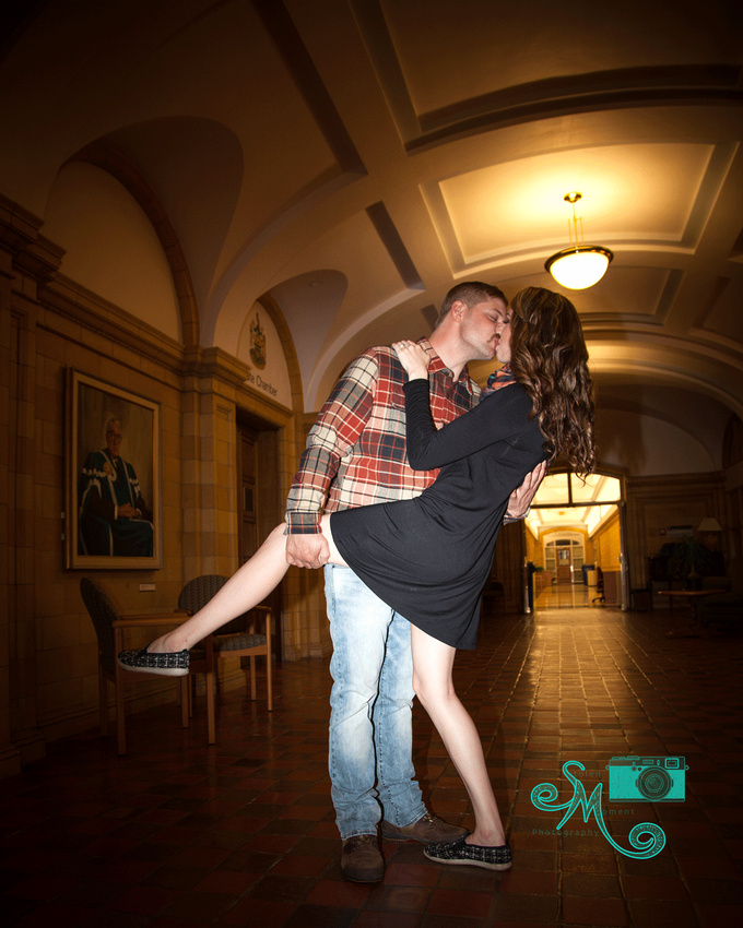 a man dips his fiance in the halls at convocation hall at the U of A