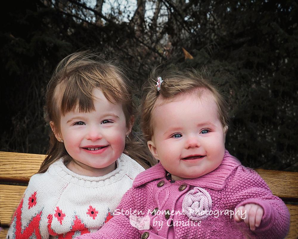 two sisters smiling at camera