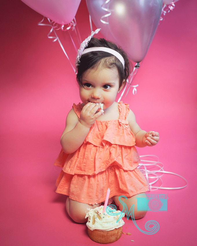 one year old little girl eating cake