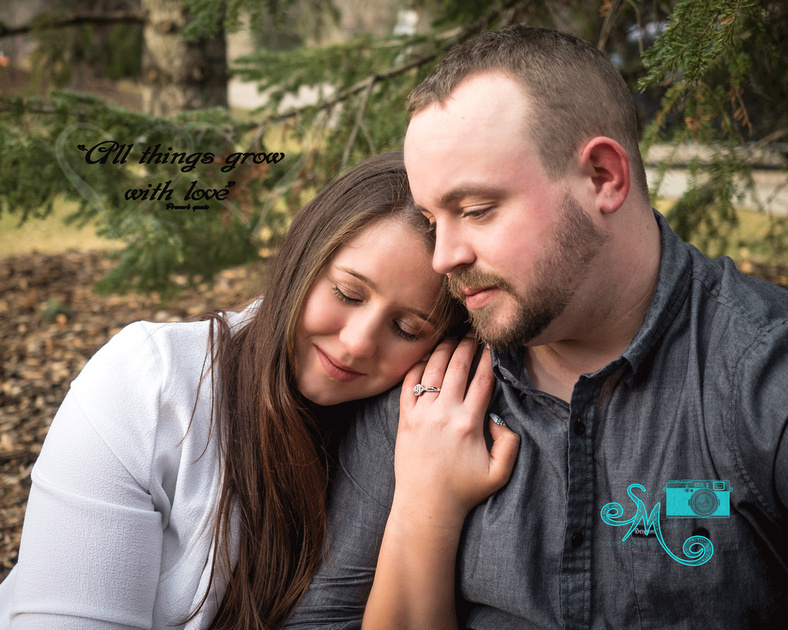 woman snuggles with her fiancé