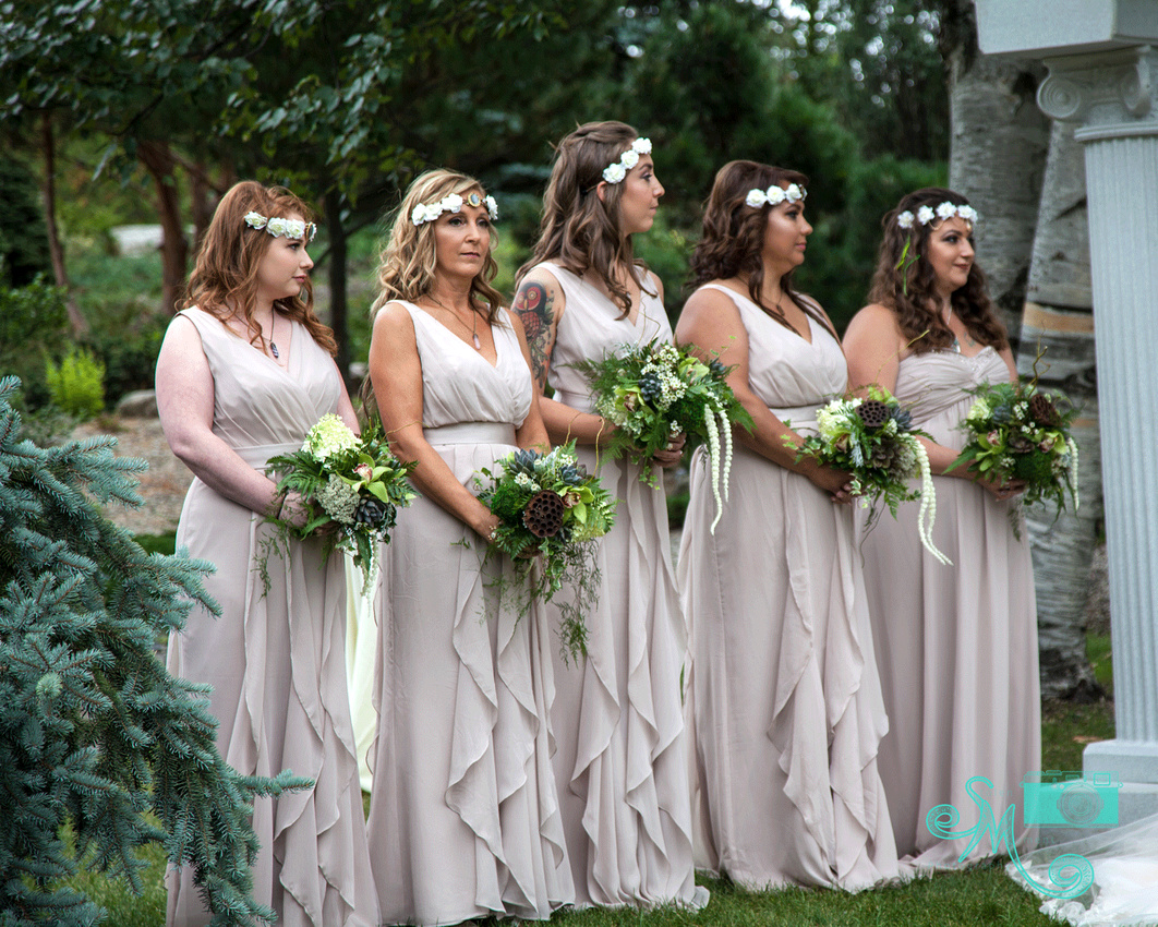bridesmaids standing at altar