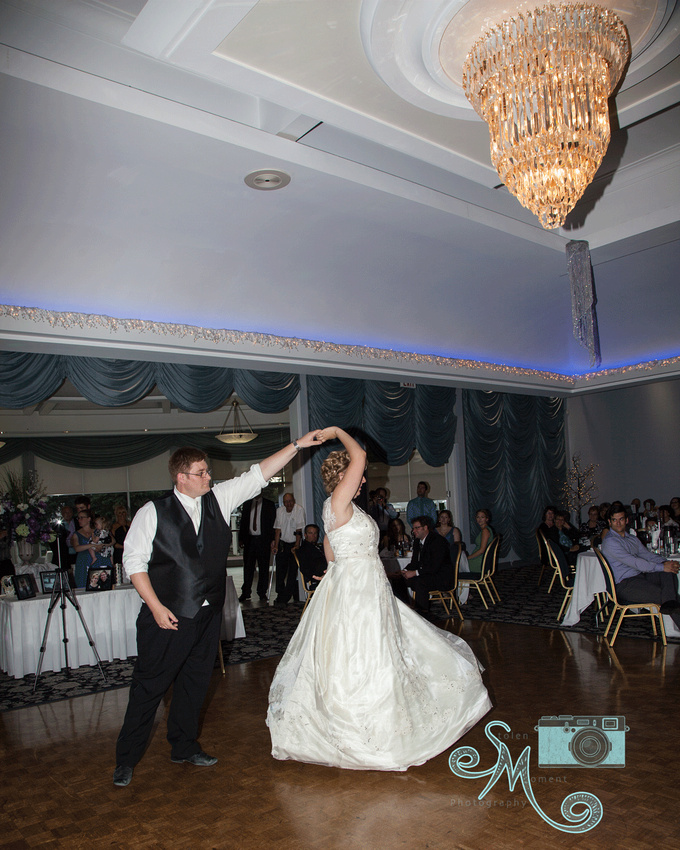 groom twirling bride during first dance