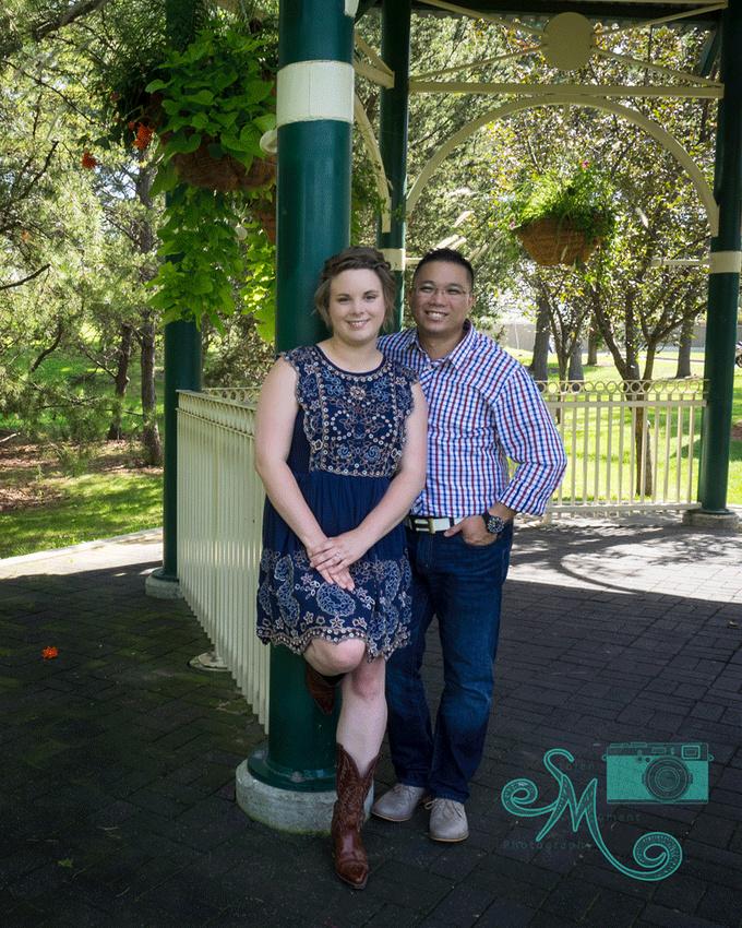 couple posing under gazebo