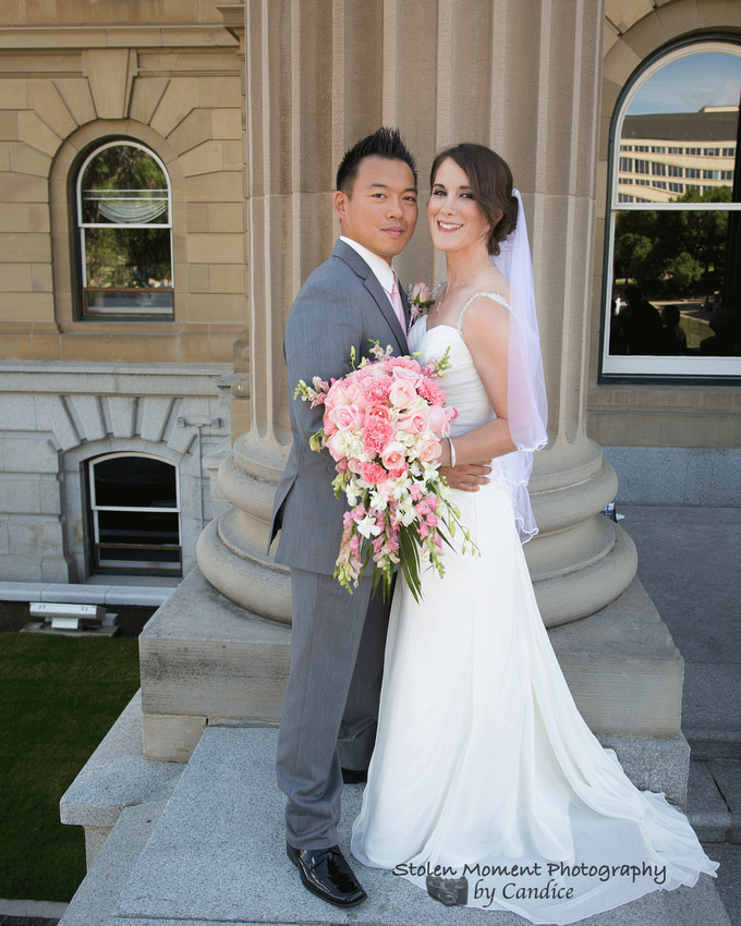 Bride and Groom on ledge at the Legislature Grounds in Edmonton