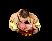 Firefighter and newborn