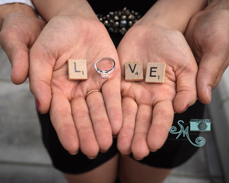 love spelled out in woman's hand