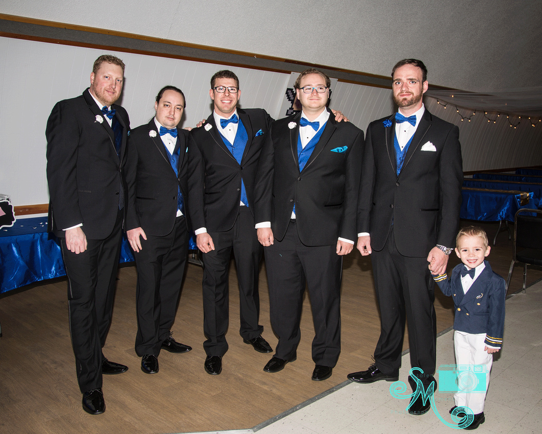 the groom and groomsmen pose for a guy shot