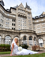 Bride sitting on grass on grounds of Fairmont Hotel McDonald