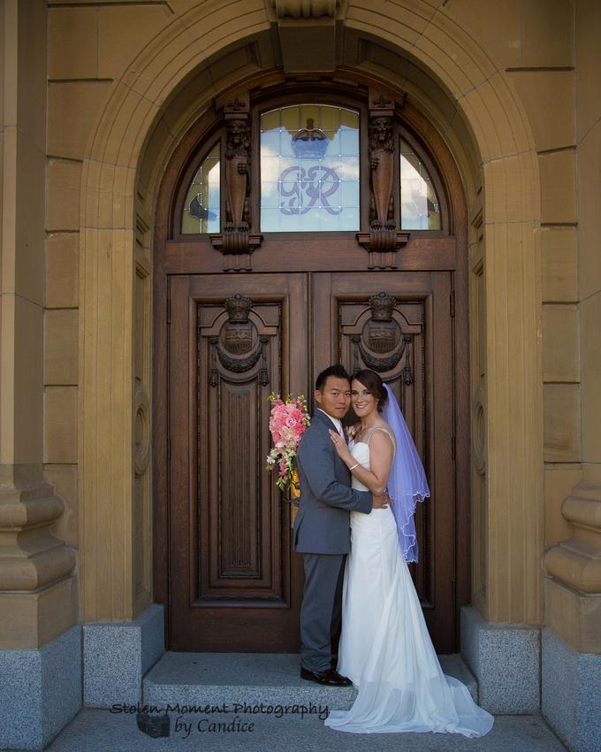 Bride and Groom in front of door at Legislature grounds