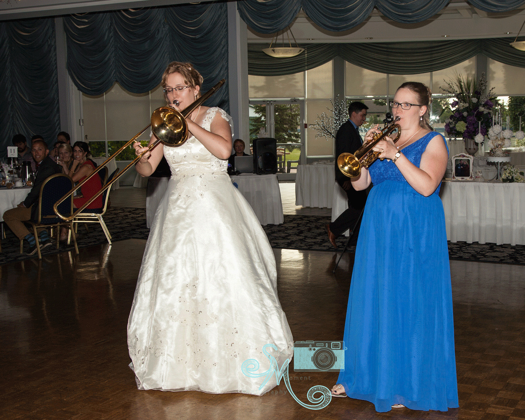 Bride and her sister playing instruments