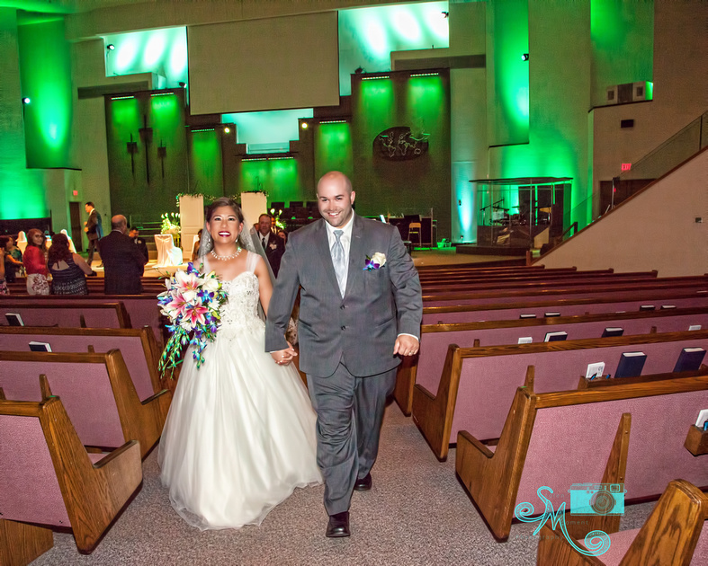 the bride and groom walk back down the aisle as Mr. and Mrs.