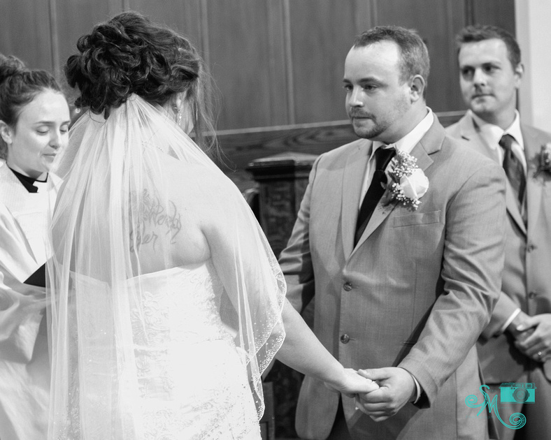 a groom has his first look at his beautiful bride