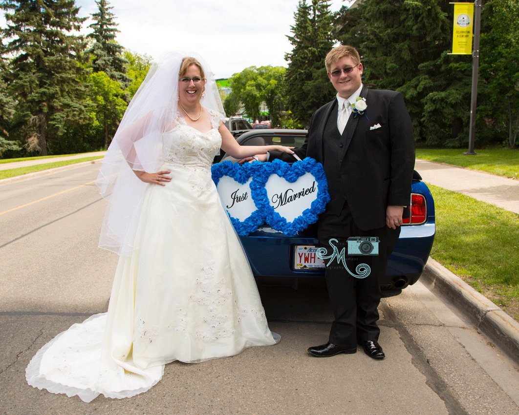 bride and groom with 2007 Shelby Mustang