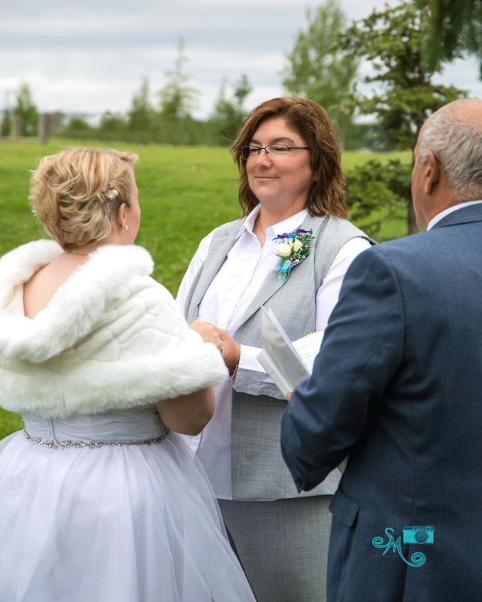 a bride looks adoringly into her bride's eyes