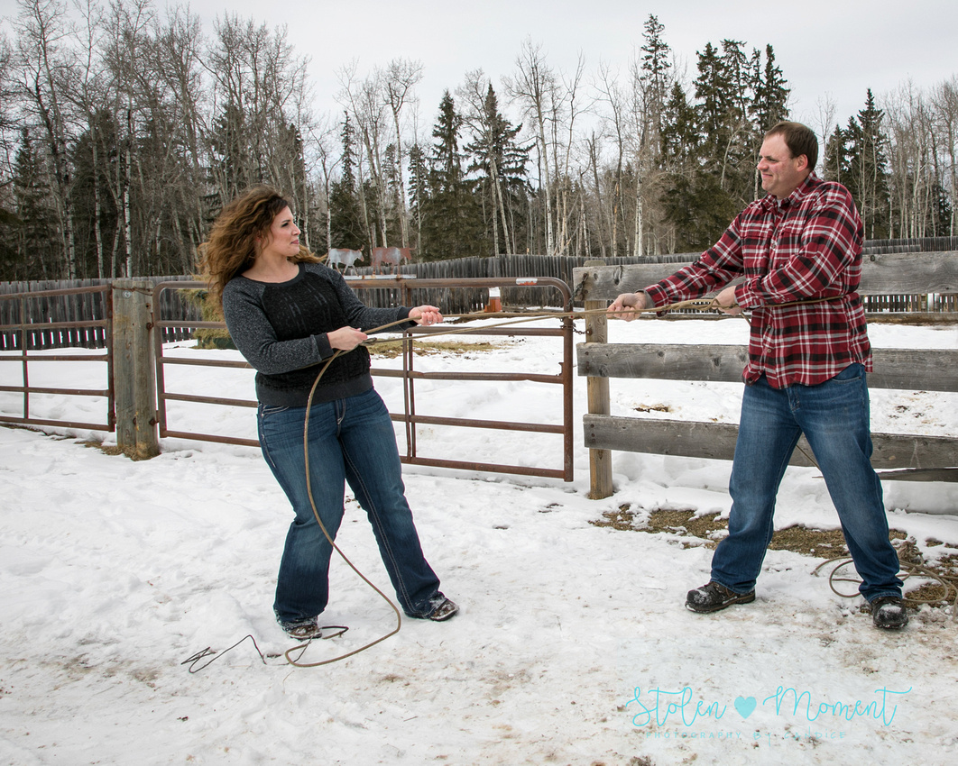 a man and his fiance catch each other in a rope and have a tug of war